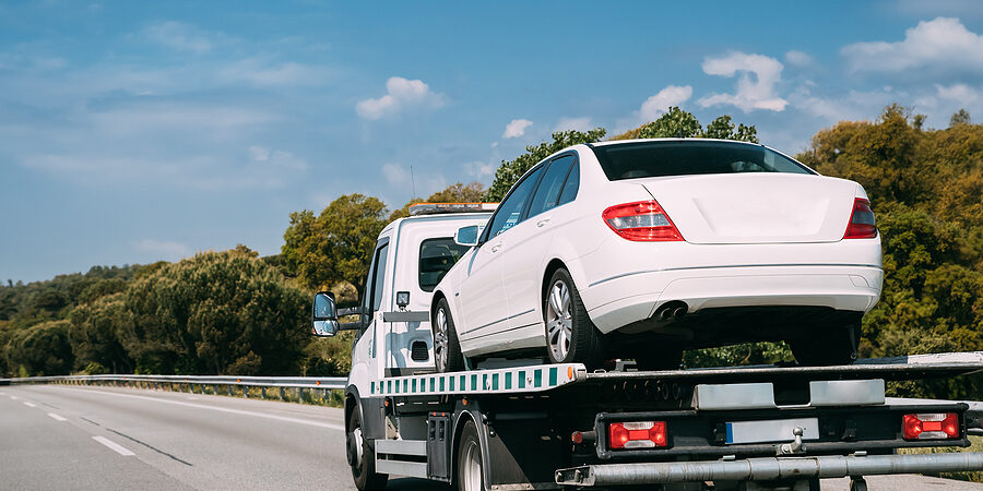 Car Service Transportation Concept. Tow Truck Transporting Car Or Help On Road Transports Wrecker Broken Car. Auto Towing, Tow Truck For Transportation Faults And Emergency Cars . Tow Truck Moving In Motorway Freeway Highway.
